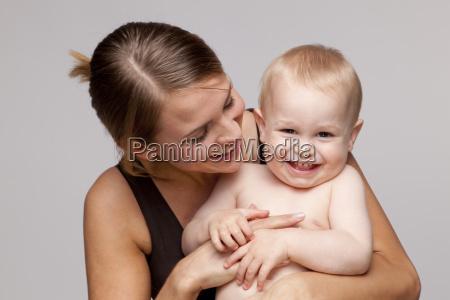 portrait of happy shirtless baby boy