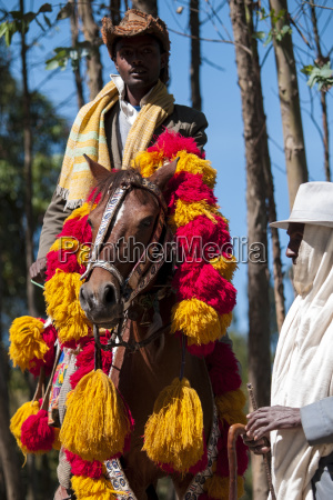 a man rides his horse with