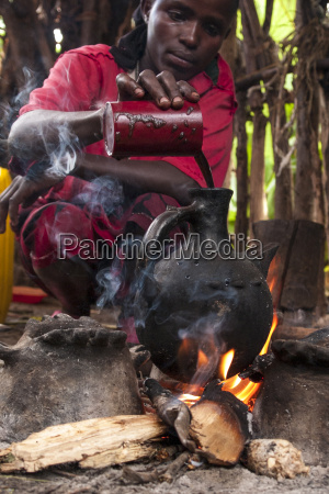 a woman pours into a traditional