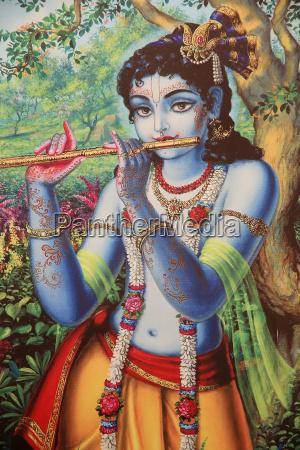 painting depicting hindu god krishna playing