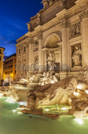 the trevi fountain backed by the