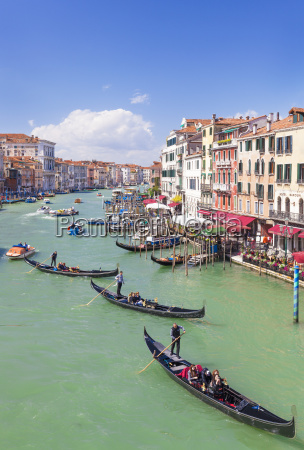 gondolas with tourists on the grand