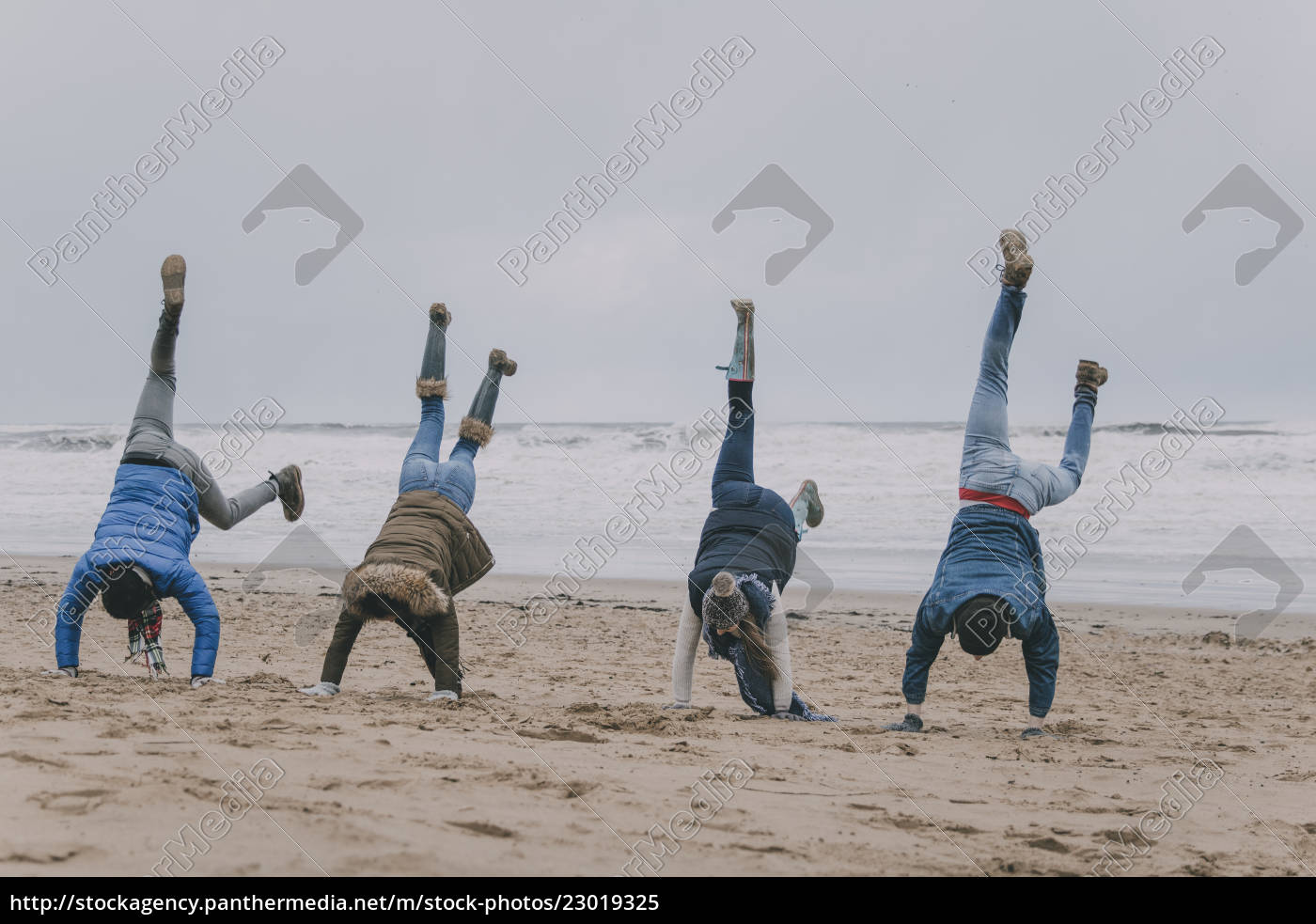 friends, doing, handstands, on, a, winter - 23019325